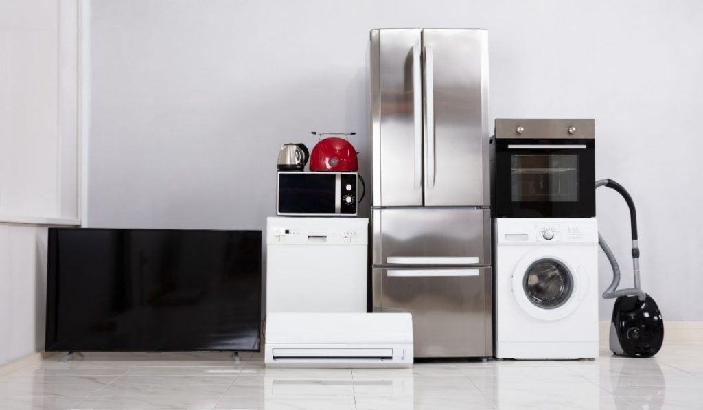 complete appliances on the floor in an empty apartment