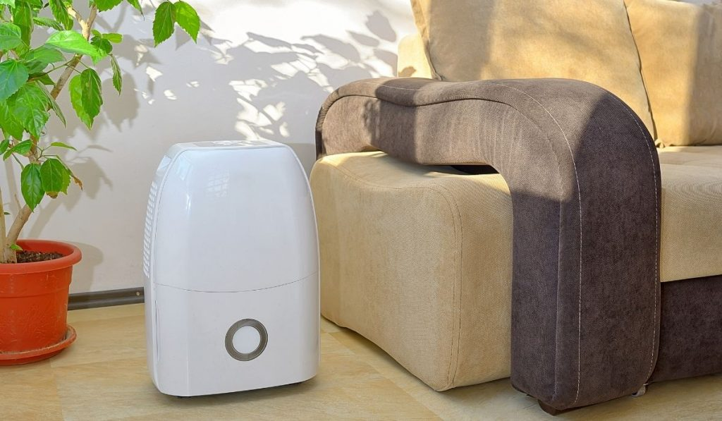 dehumidifier beside a couch