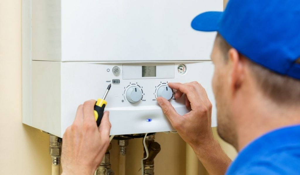 technician setting the up the water heater