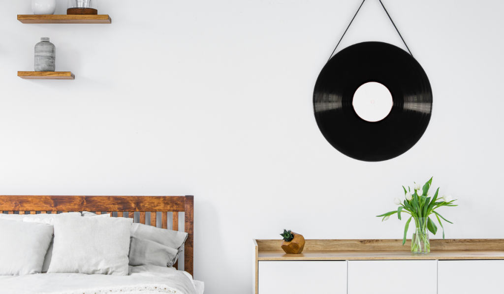 vinyl record mirror hanged on a white wall.