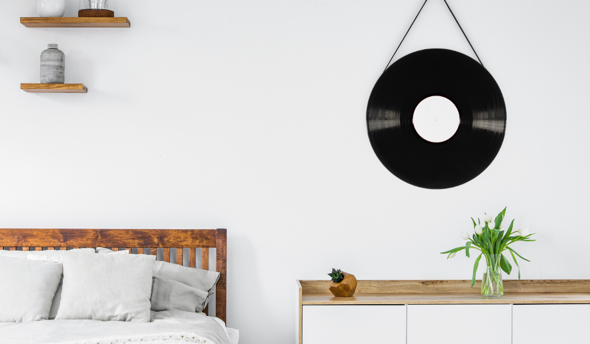 record mirror hanging on the wall bedroom